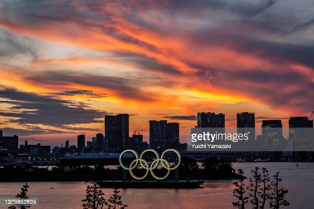 Olympics rings are seen at sunset on July 21, 2021 in Tokyo, Japan. With the Olympics now just a few days away, Tokyo is bracing itself for a Games...