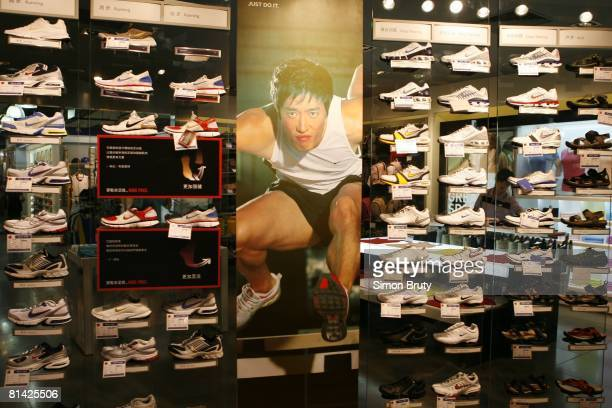 Olympics Summer Games Preview View of hurdler Liu Xiang advertisment on Nike sneaker display in sporting goods store at mall Beijing China 6/21/2007