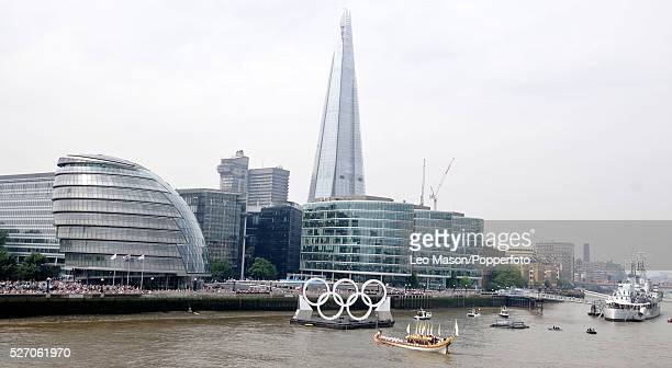 Olympics Torch Relay arrives at London's City Hall aboard the Royal Barge Gloriana with The Shard and HMS Bellfast in the background Headline...