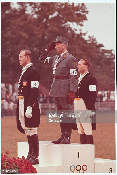 Olympics1964 Japan Tokyo Winners of the Equestrian Grand Prix De Dressage event on the victory stand first place Henry Chammartin of Switzerland...