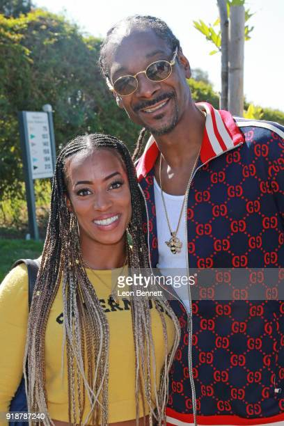 OlympicTrack athlete Lisa Barber and music artist Snoop Dogg attends the Golf Beef 4 Honoring Cedric The Entertainer and Gary Payton The Glove at...