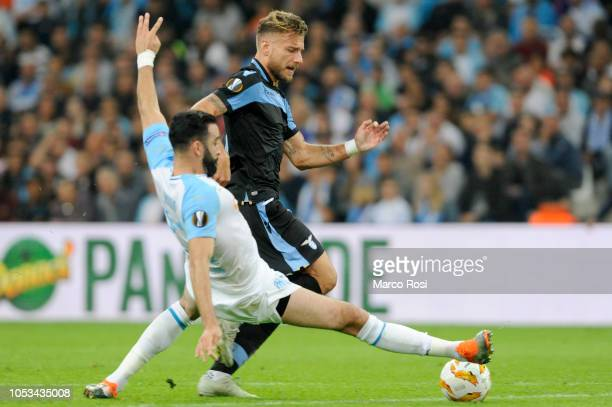 Olympique de Marseille Adil Rami compete for the ball with Ciro Immobile of SS Lazio during the UEFA Europa League Group H match between Olympique de...