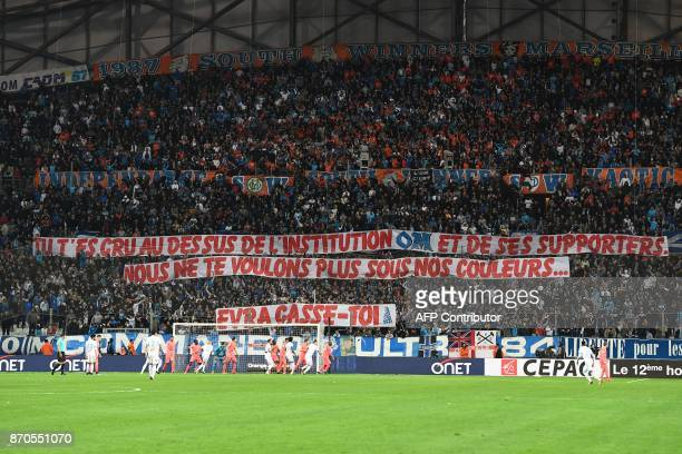 Olympique de Marseille fans hold a banner reading 'You thought you were above the institution OM and its supporters We don't want you wearing our...