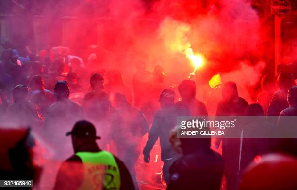 Olympique de Marseille fans light flares outside the San Mames stadium before the UEFA Europa League round of sixteen second leg football match...