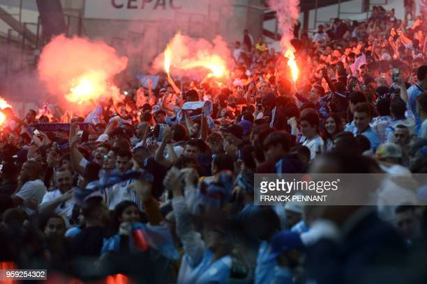Olympique de Marseille fans react as they watch the Europa League final match Atletico Madrid against Marseille on May 16 2018 at the Velodrome...