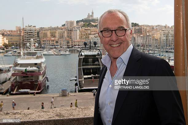 Olympique de Marseille football club new owner Frank McCourt poses for a photograph on the balcony of the city hall of Marseille following a press...