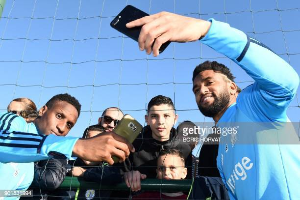 Olympique de Marseille forward Bouna Sarr and defender Jordan Amavi pose for supporters during a training session on January 5 2018 at the...