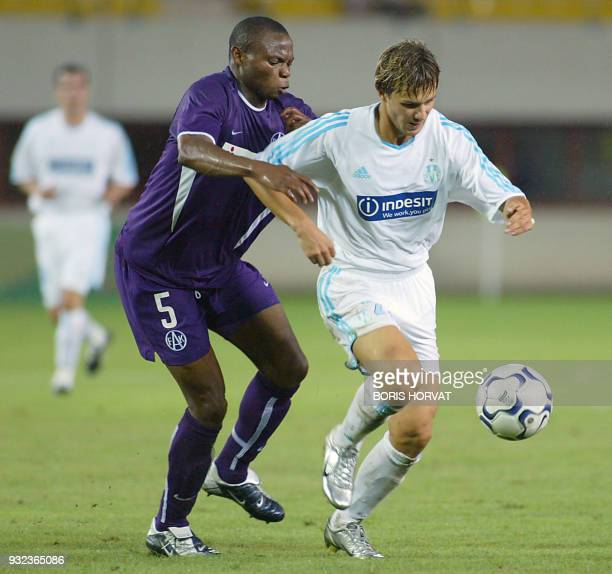 Olympique de Marseille forward Russian Dimitri Sytchev is challenged by Austria Vienna defender Rabiu Afoladi during the first Champions league...
