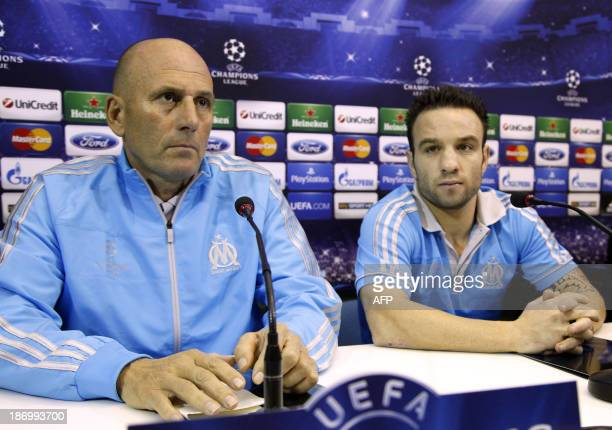 Olympique de Marseille head coach Elie Baup and midfielder Mathieu Valbuena attend a press conference on November 5 in Naples on the eve of the UEFA...