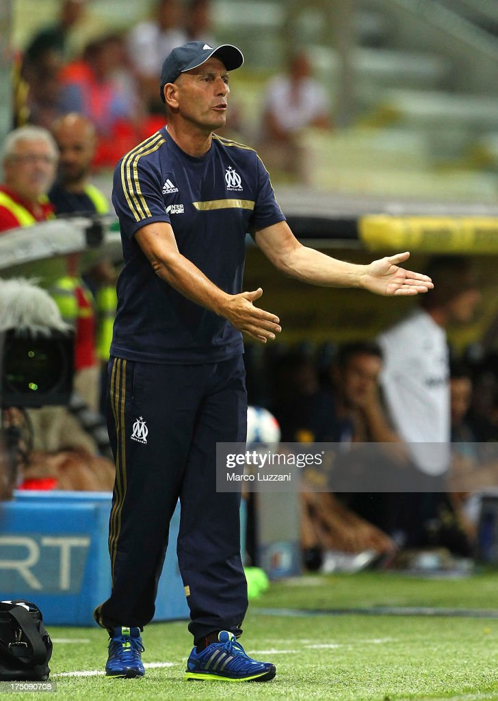 Olympique de Marseille manager Elie Baup issues instructions to his players during the pre-season friendly match between Parma FC and Olympique de Marseille at Stadio Ennio Tardini on July 31, 2013 in Parma, Italy.