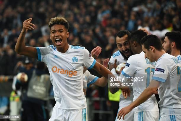 Olympique de Marseille players celebrate their team's second goal during the Europa League quarter final second leg football match Olympique de...