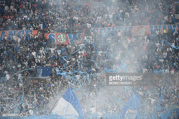 Olympique de Marseille supporters cheer during their French L1 football match Olympique of Marseille versus Lyon at the Velodrome stadium in...
