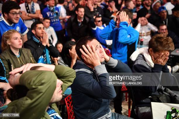 Olympique de Marseille supporters react in the Vieux Port in Marseille on May 16 as they watch the 2018 UEFA Europa Cup Final football match between...