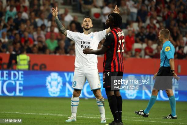 Olympique de Marseille's Argentine forward Dario Benedetto celebrates after scoring a goal during the French L1 football match between OGC Nice and...