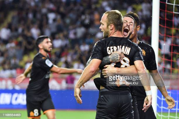Olympique de Marseille's Argentine forward Dario Benedetto celebrates with Olympique de Marseille's French forward Valere Germain who scores a goal...