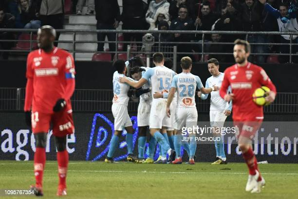 Olympique de Marseille's Argentinian forward Lucas Ocampos celebrates with teammates after scoring a goal during the French L1 football match Dijon...