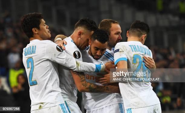 Olympique de Marseille's Argentinian forward Lucas Ocampos celebrates with teammates after scoring a goal during the UEFA Europa League football...
