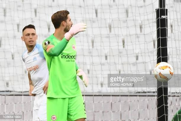 Olympique de Marseille's Argentinian forward Lucas Ocampos celebretes after scoring past Frankfurt's German goalkeeper Kevin Trapp during the UEFA...