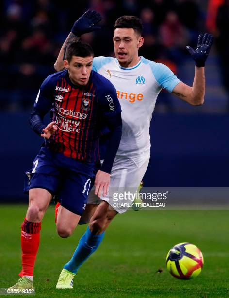 Olympique de Marseille's Argentinian forward Lucas Ocampos vies for the ball with Caen's French defender Frederic Guilbert during the French L1...