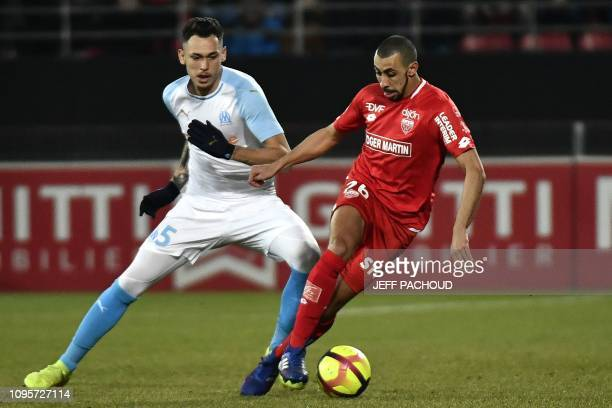Olympique de Marseille's Argentinian forward Lucas Ocampos vies with Dijon's French defender Fouad Chafik during the French L1 football match between...