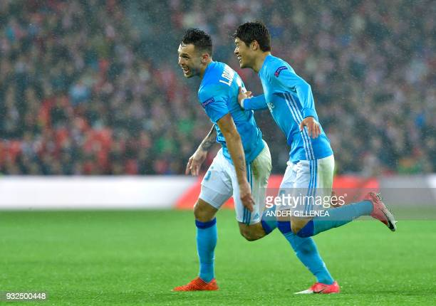 Olympique de Marseille's Argentinian midfielder Lucas Ocampos celebrates scoring his team's second goal with Marseille's Japanese defender Hiroki...