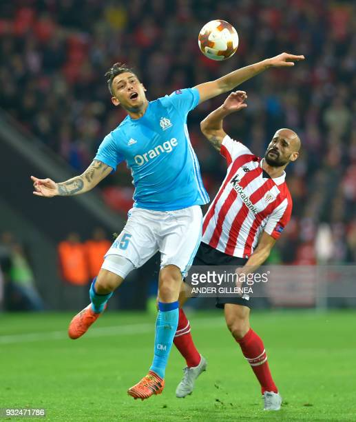 Olympique de Marseille's Argentinian midfielder Lucas Ocampos vies with Athletic Bilbao's Spanish midfielder Mikel Rico during the UEFA Europa League...