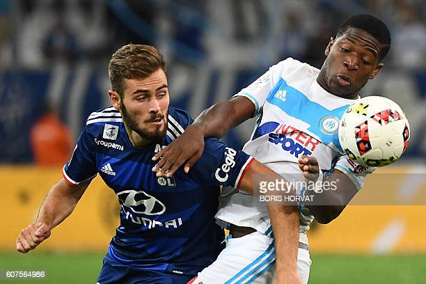 Olympique de Marseille's Belgian forward Aaron Leya Iseka competes for the ball with Lyon's French midfielder Lucas Tousart during their French L1...