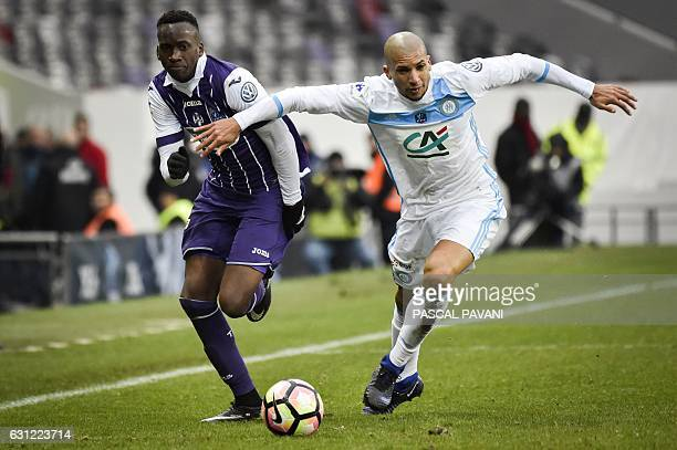 Olympique de Marseille's Brazilian defender Matheus Doria Macedo vies with Toulouse's Belgium midfielder Dodi Lukebakio during the French Cup...