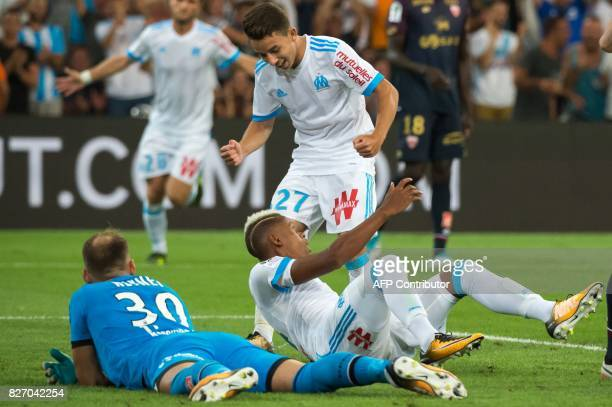 Olympique de Marseille's Cameroonian forward Clinton Njie is congratulated by Olympique de Marseille's French midfielder Maxime Lopez after scoring a...