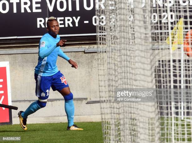Olympique de Marseille's Cameroonian forward Clinton Njie jubilates after scoring during the French L1 football match between Amiens and Marseille on...