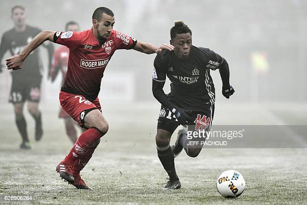 Olympique de Marseille's Cameroonian forward Clinton Njie vies with Dijon's French defender Fouad Chafik during the French L1 football match Dijon vs...