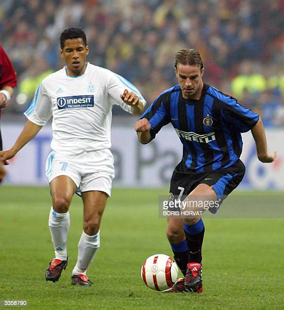 Olympique de Marseille's defender Sylvain N'Diaye fights for the ball against Inter Milan's forward Andy Van Der Meyde during their quaterfinal UEFA...