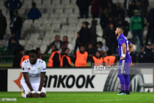 Olympique de Marseille's Dimitri Payet and Konyaspor's Wilfried Moke react after the end of the UEFA Europa League Group I football match between...
