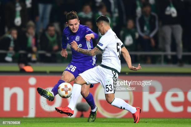 Olympique de Marseille's Florian Thauvin vies for the ball with Konyaspor's Musa Araz during the UEFA Europa League Group I football match between...
