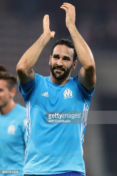 Olympique de Marseille's French defender Adil Rami reacts at the end of French L1 football match between Nice and Marseille on October 1 2017 at the...