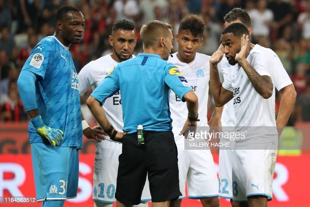 Olympique de Marseille's French defender Jordan Amavi argues with referee before a penalty kick during the French L1 football match between OGC Nice...