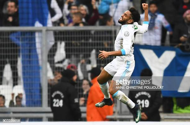 Olympique de Marseille's French defender Jordan Amavi jumps as he celebrates after scoring a goal during the French Cup football match between...