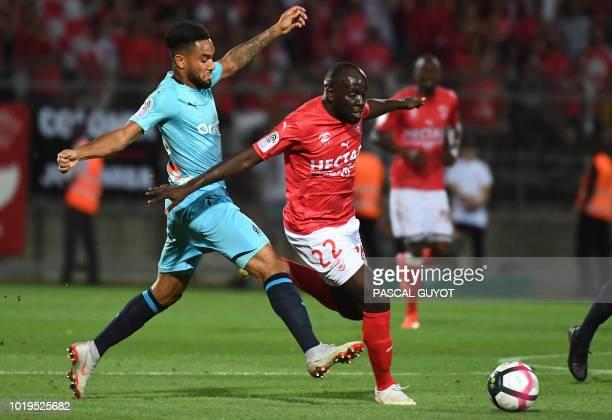 Olympique de Marseille's French defender Jordan Amavi vies with Nîmes' French forward Sada Thioub during the French L1 football match Nîmes vs...