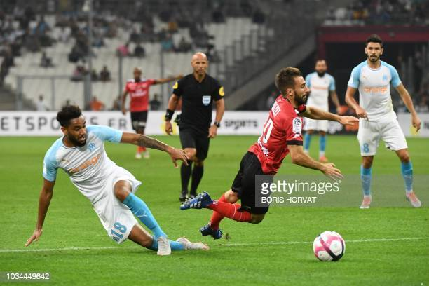Olympique de Marseille's French defender Jordan Amavi vies with Guingamp's French midfielder Nicolas Benezet during the French L1 football match...