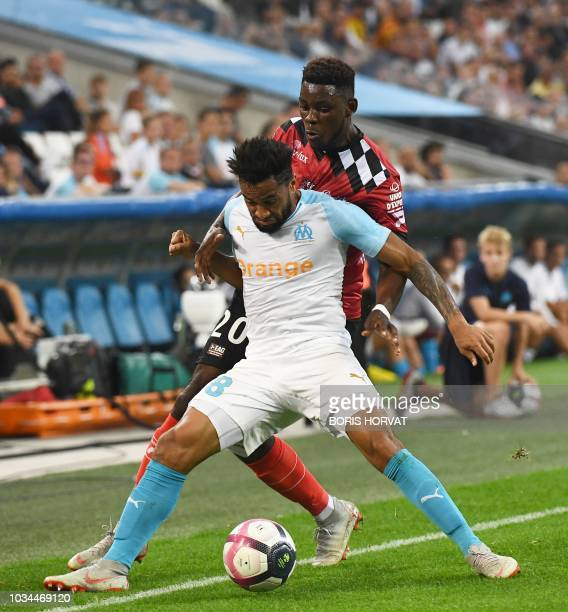 Olympique de Marseille's French defender Jordan Amavi vies with Guingamp's Cameroonian defender Félix Eboa Eboa during the French L1 football match...
