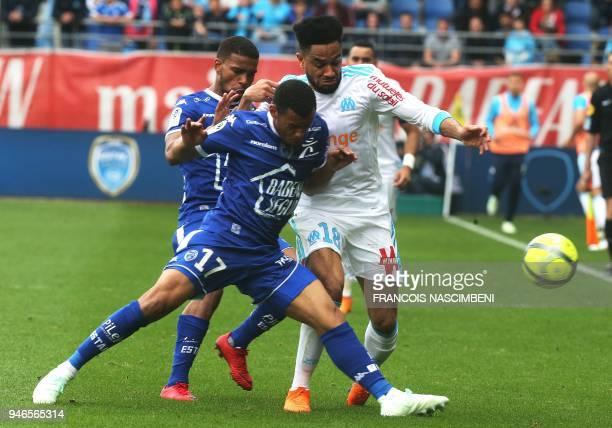 Olympique de Marseille's French defender Jordan Amavi vies with Troyes' Gabonese defender Johann Obiang during the French L1 football match between...