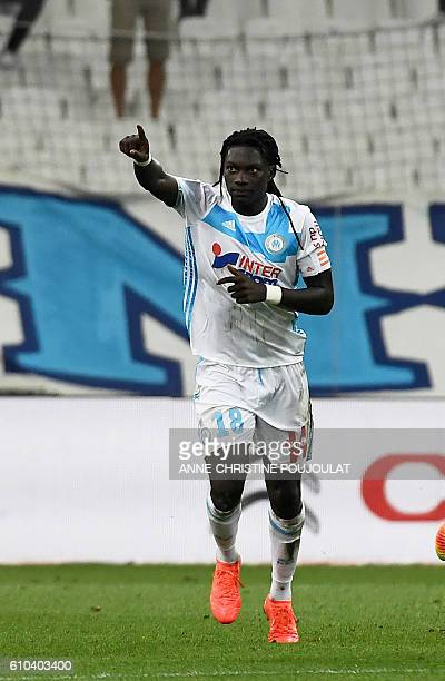 Olympique de Marseille's French forward Bafetimbi Gomis celebrates afer scoring a goal during the French L1 football match Marseille vs Nantes on...