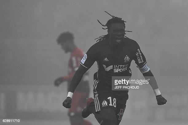 Olympique de Marseille's French forward Bafetimbi Gomis celebrates after scoring a goal during the French L1 football match Dijon vs Marseille on...