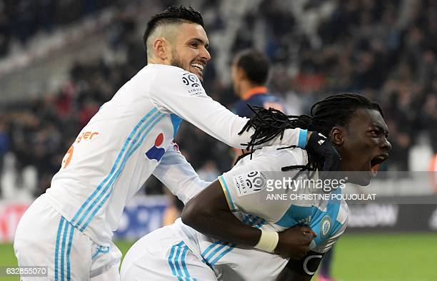 Olympique de Marseille's French forward Bafetimbi Gomis celebrates after scoring a goal with teammate Olympique de Marseille's French midfielder Remy...