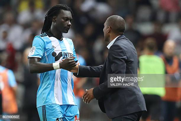 Olympique de Marseille's French forward Bafetimbi Gomis celebrates with his coach Franck Passi after scoring a goal during the French L1 football...