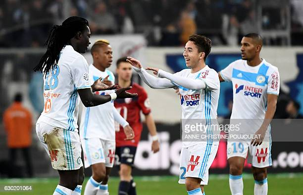 Olympique de Marseille's French forward Bafetimbi Gomis celebrates with Olympique de Marseille's French midfielder Maxime Lopez after scoring during...