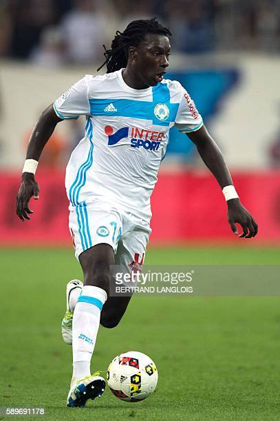 Olympique de Marseille's French forward Bafetimbi Gomis runs with the ball during the French Ligue 1 football match Olympique de Marseille OM vs...