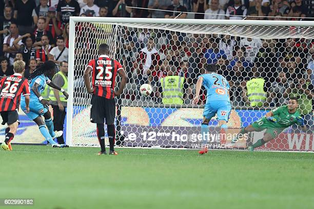 Olympique de Marseille's French forward Bafetimbi Gomis scores a goal during the French L1 football match OGC Nice vs Olympique de Marseille on...