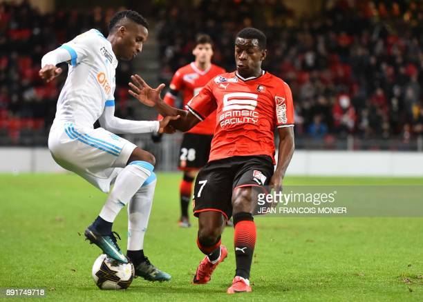 Olympique de Marseille's French forward Bouna Sarr fights for the ball with Rennes' French midfielder ChristEmmanuel Faitout Maouassa during the...