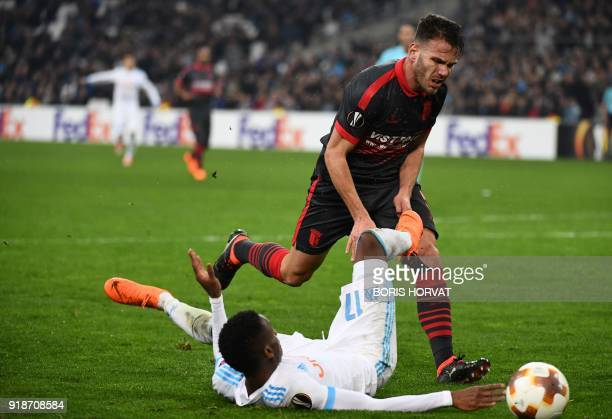 Olympique de Marseille's French forward Bouna Sarr fights for the ball with SC Braga's Portugese defender Jeronimo Sequeira during the UEFA Europa...
